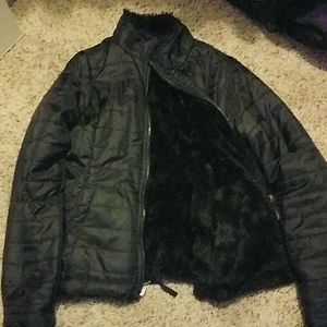 A black winter jacket with a fluffy inside